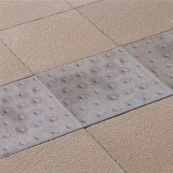 platform edge tactile flag paving - natural