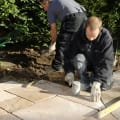 installer laying paving