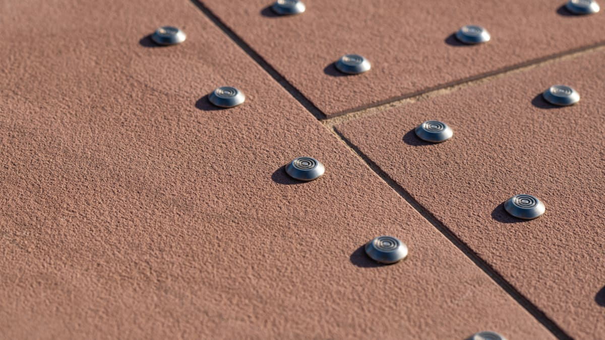 Tactile natural stone paving