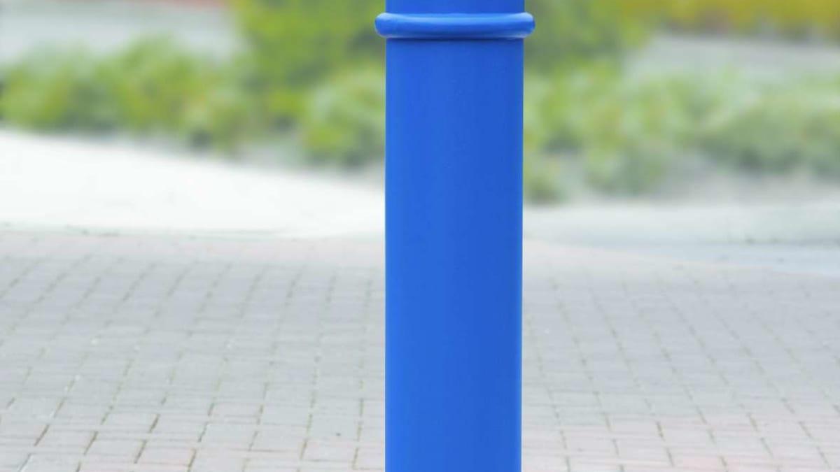 blue bollard on a pavement