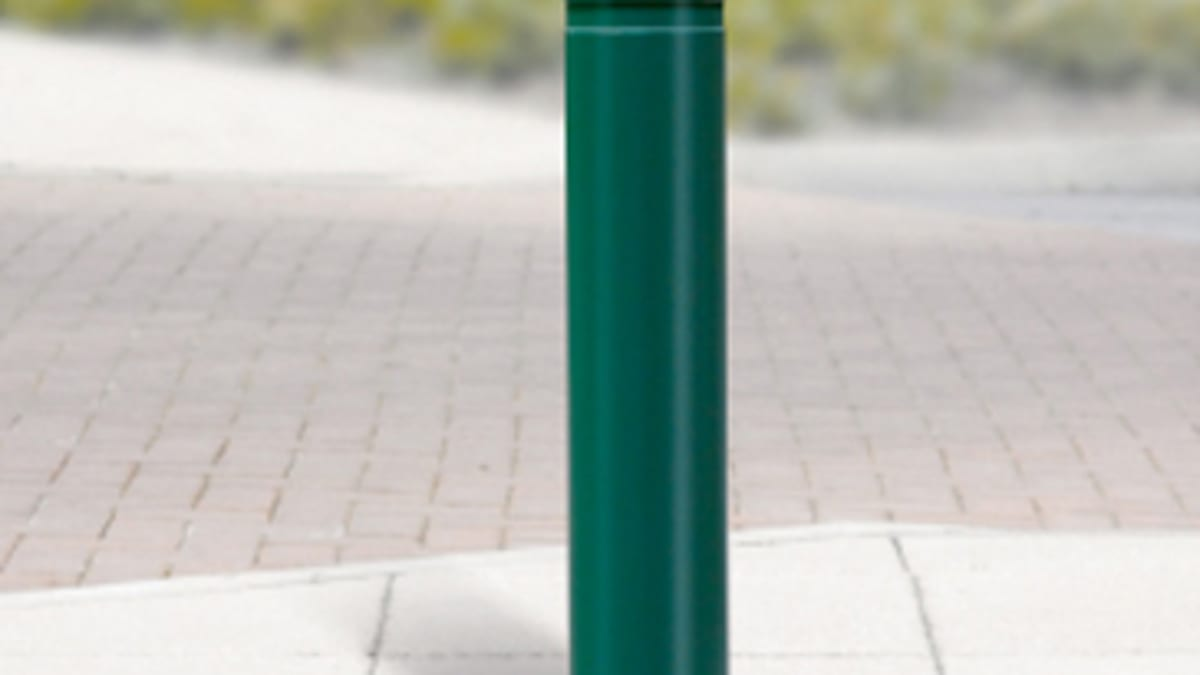 green bollard on pavemet
