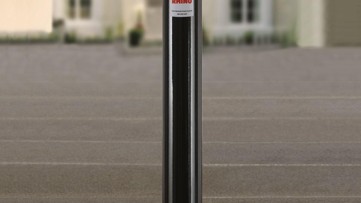 black bollard outside a building