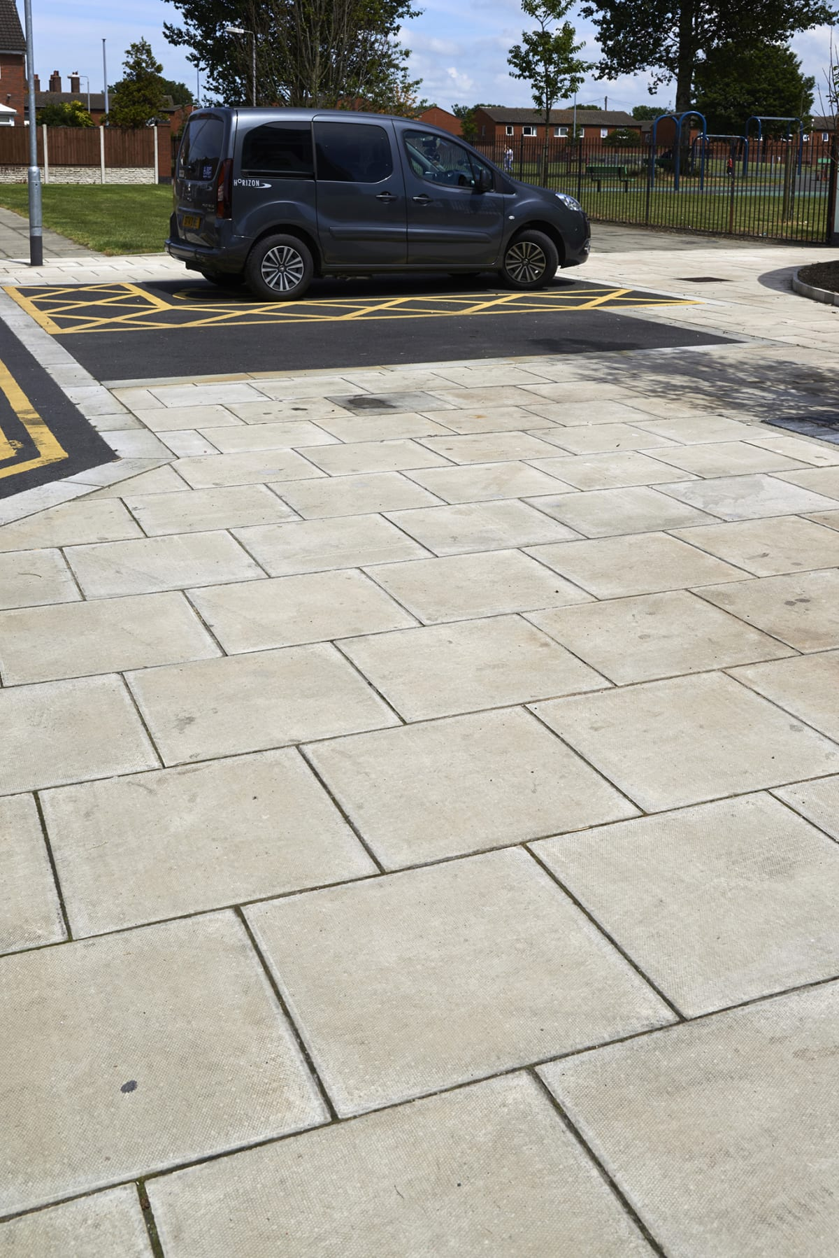 green fields place - standard pimple textured paving - buff