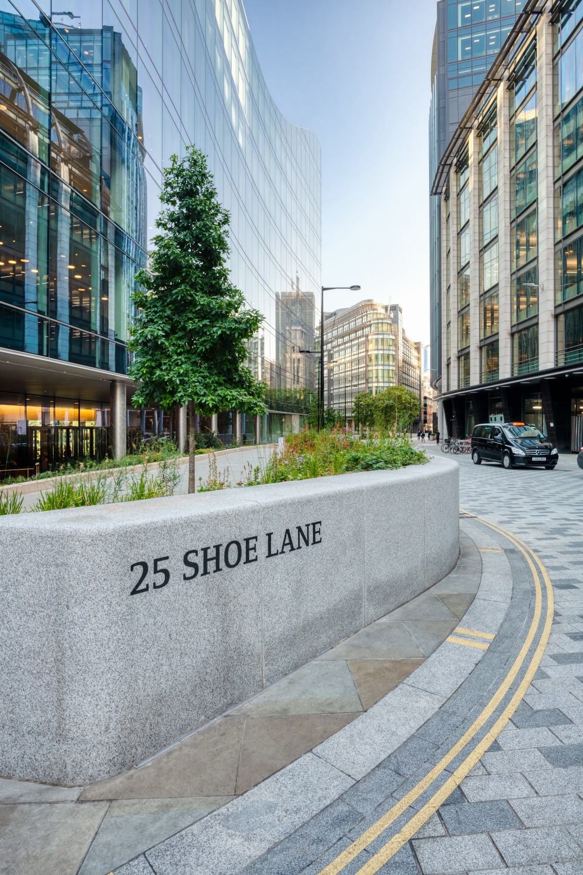Carved and hand painted address for 25 Shoe Lane