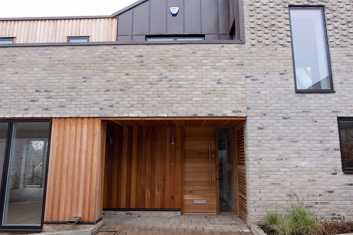 Housing development focusing on holistic house building