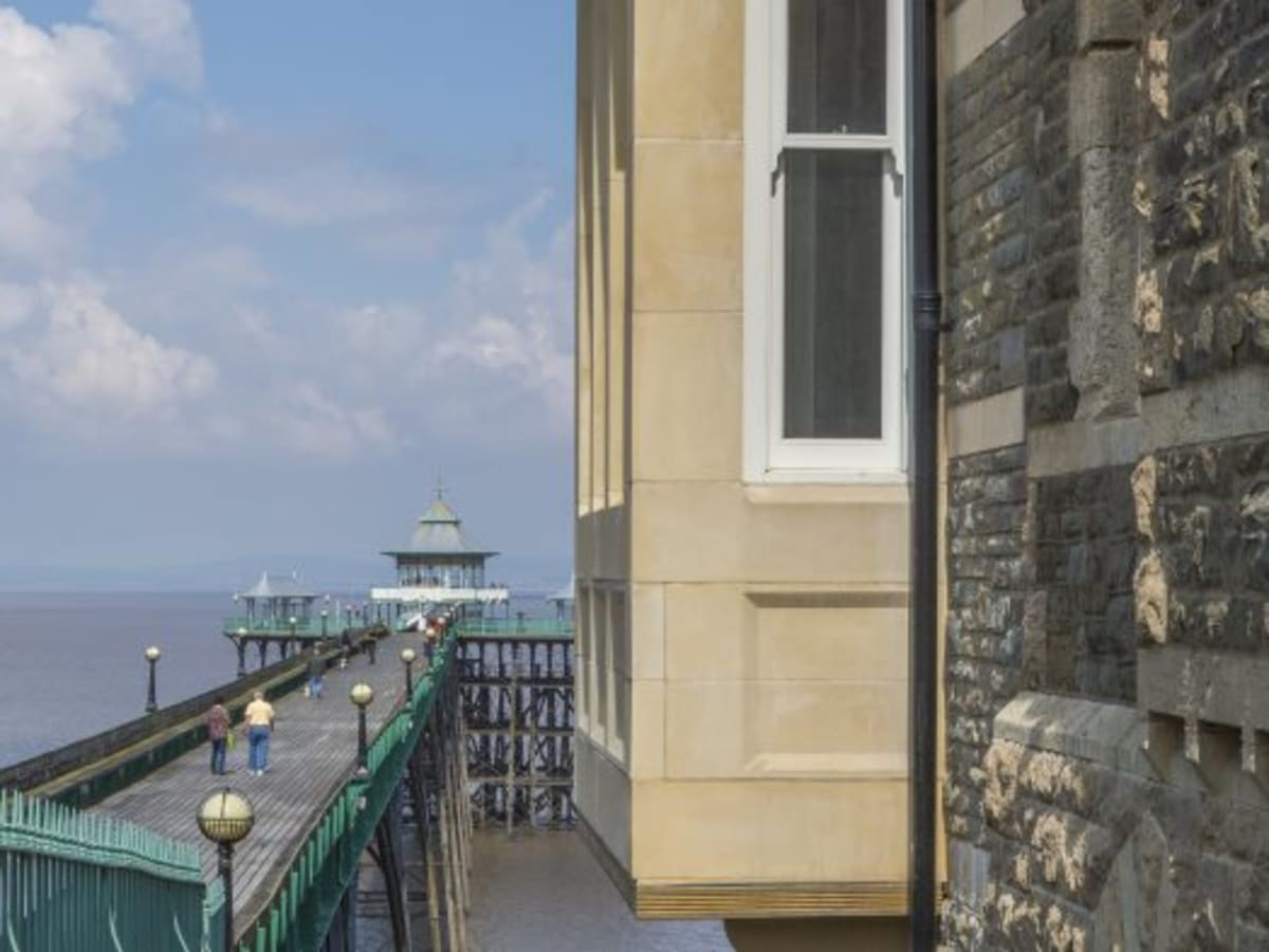 Corbels supporting box bay windows overlooking the pier