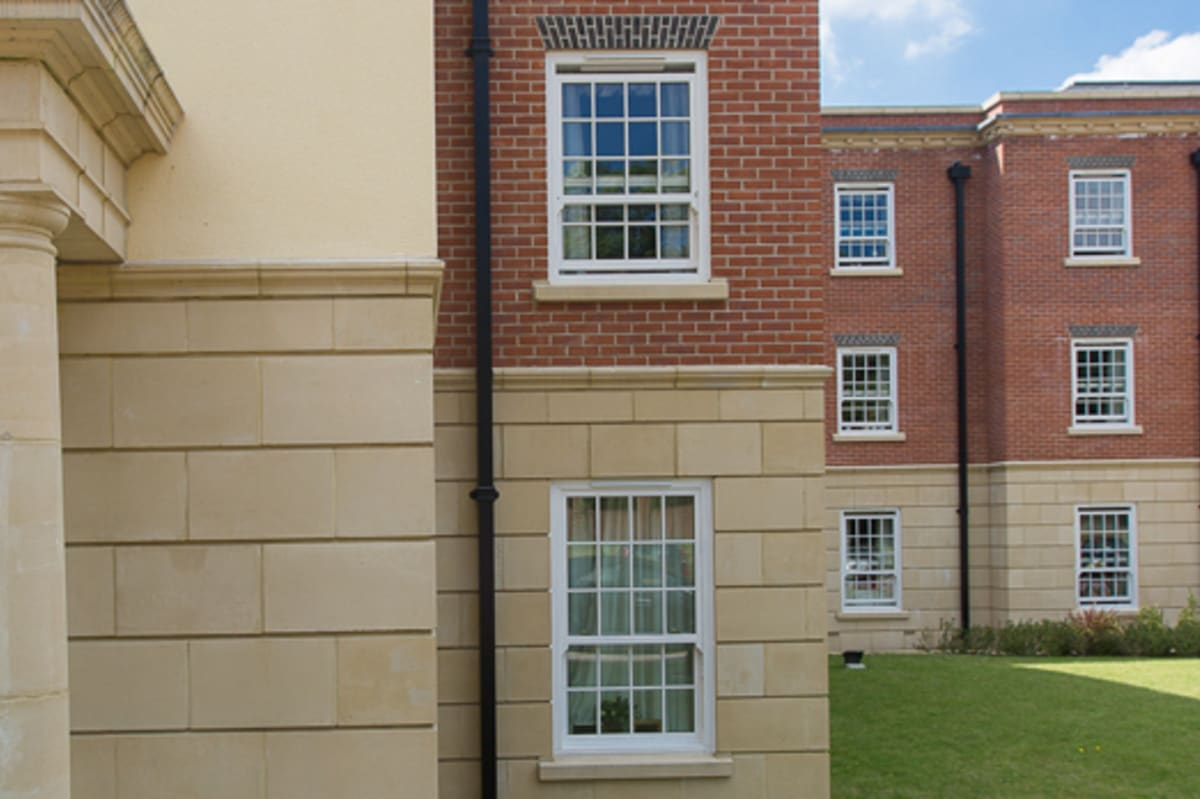 Cast stone window cills and string courses