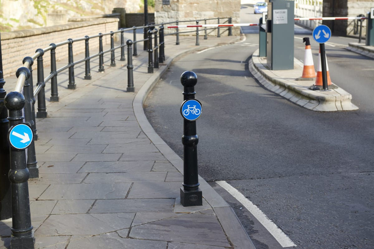 ferrocast barnstaple bollard with bespoke cycling sign