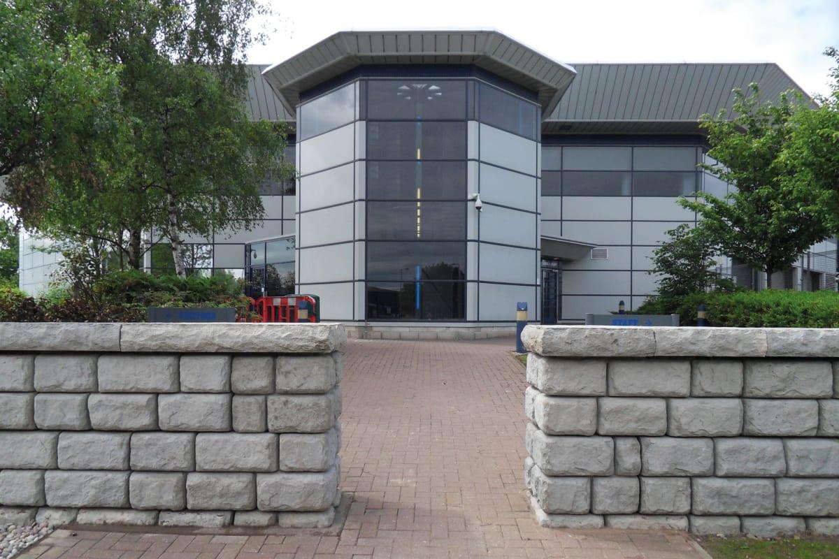 redi rock security walls protecting buildings