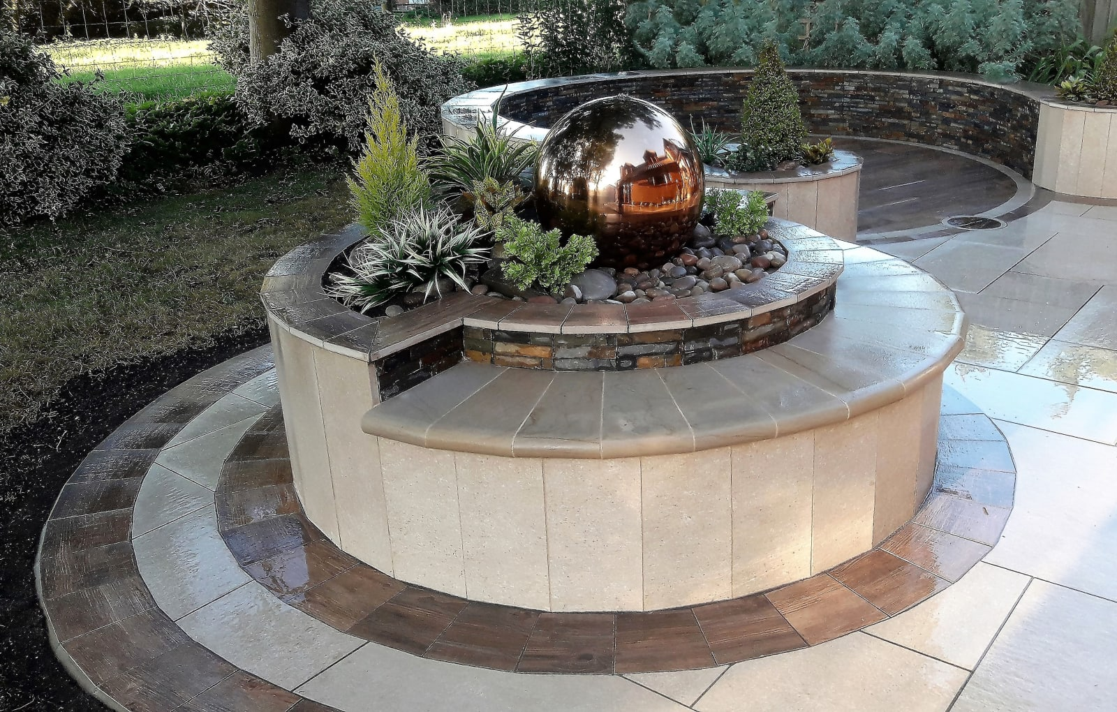 Symphony paving and Stoneface Drystack Veener Walling