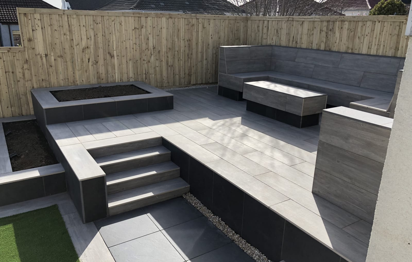 Symphony porcelain paving with bespoke seating area