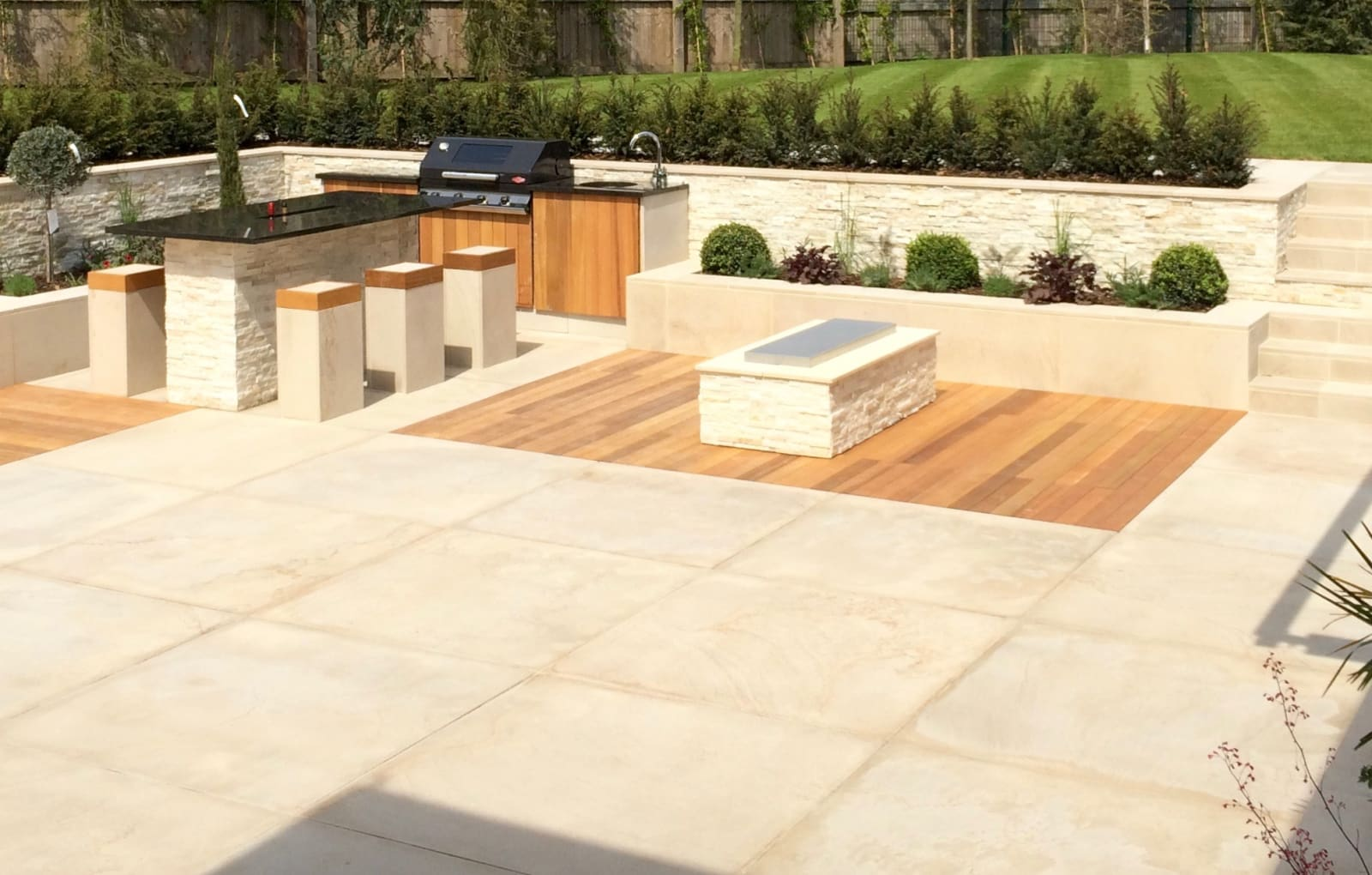 Symphony paving in Basalt and Stoneface Drysack in Nero Quartize