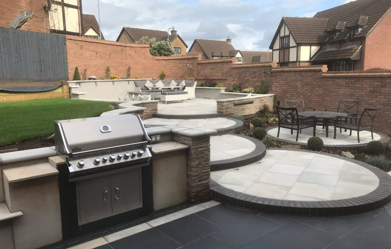 Multi-level patio with outdoor kitchen