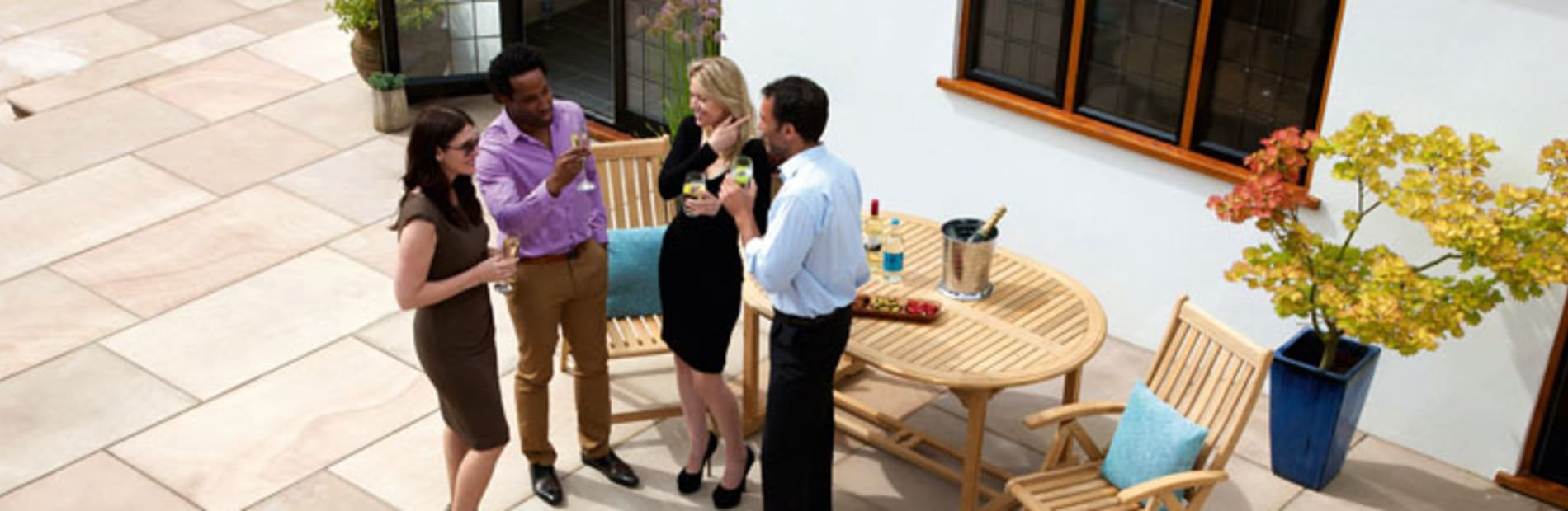 a group of friends talking in a patio area.