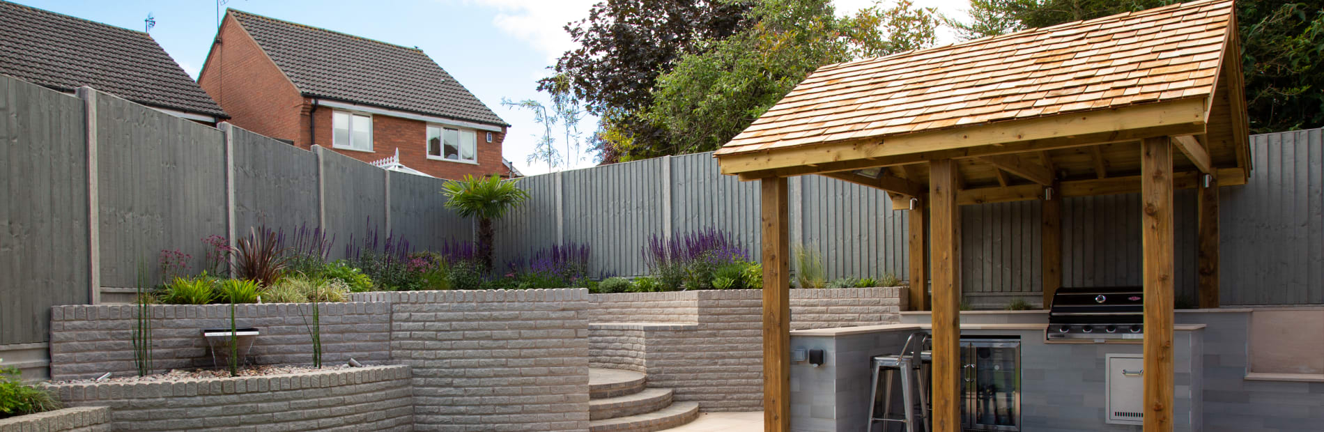 Outdoor kitchen with wooden canopy