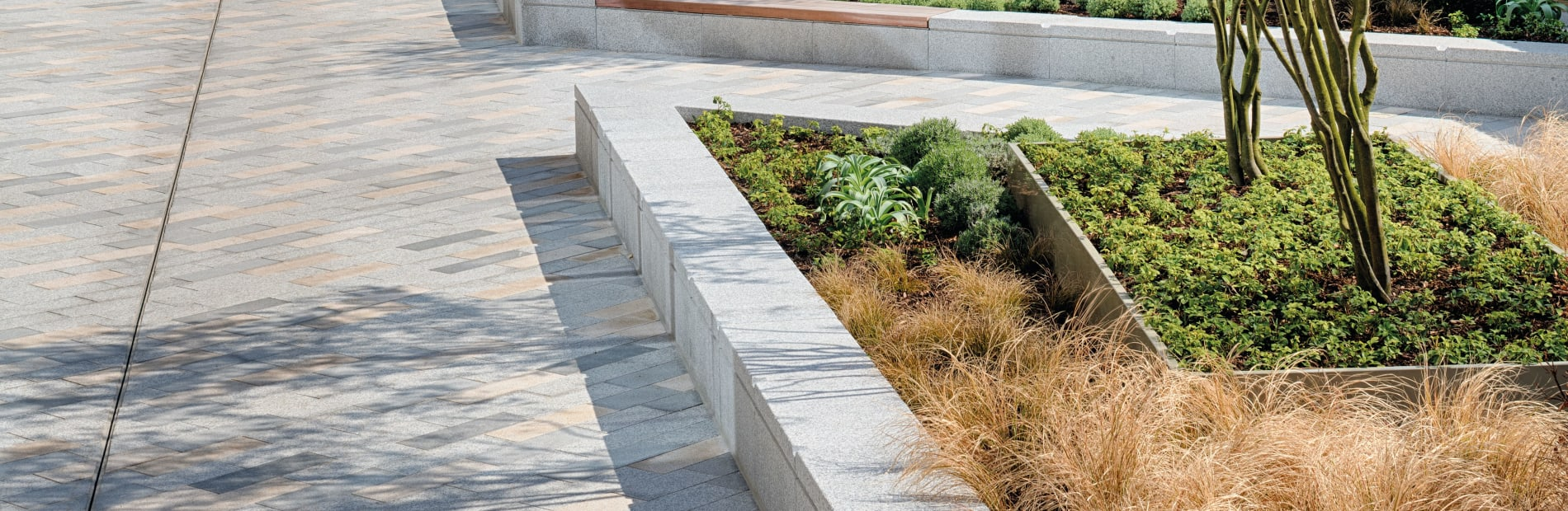 Bespoke seating and planter combination for outside business building