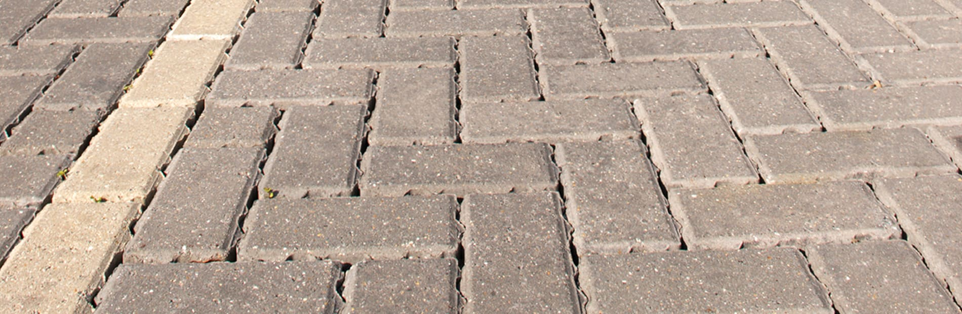 Block paving in bracken laid in a car park outside a shopping.