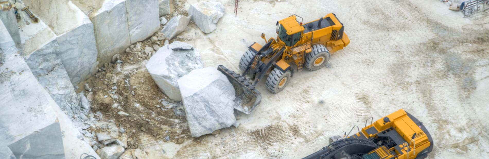 Diggers working a natural stone quarry