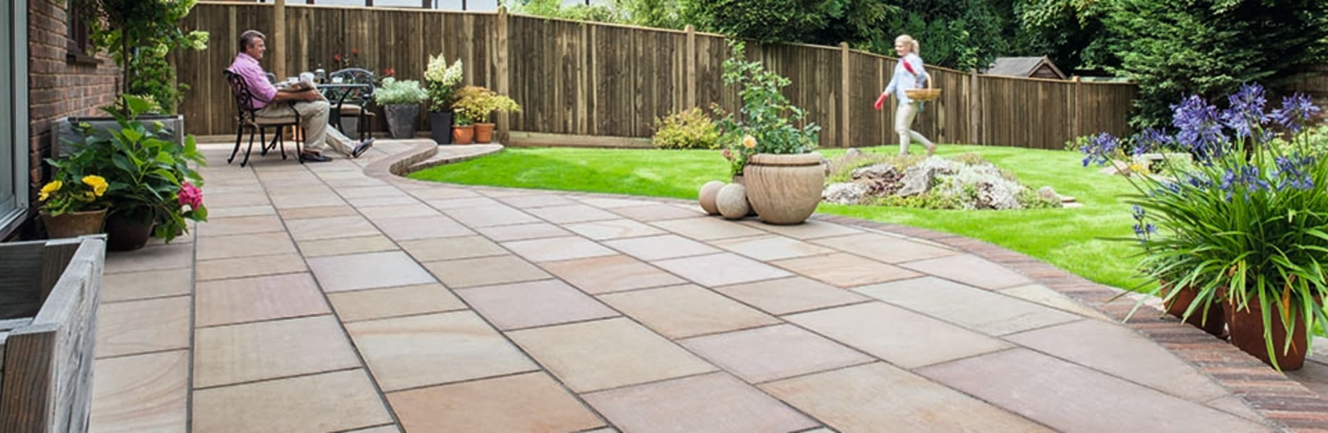buff paving laid on a garden patio area.