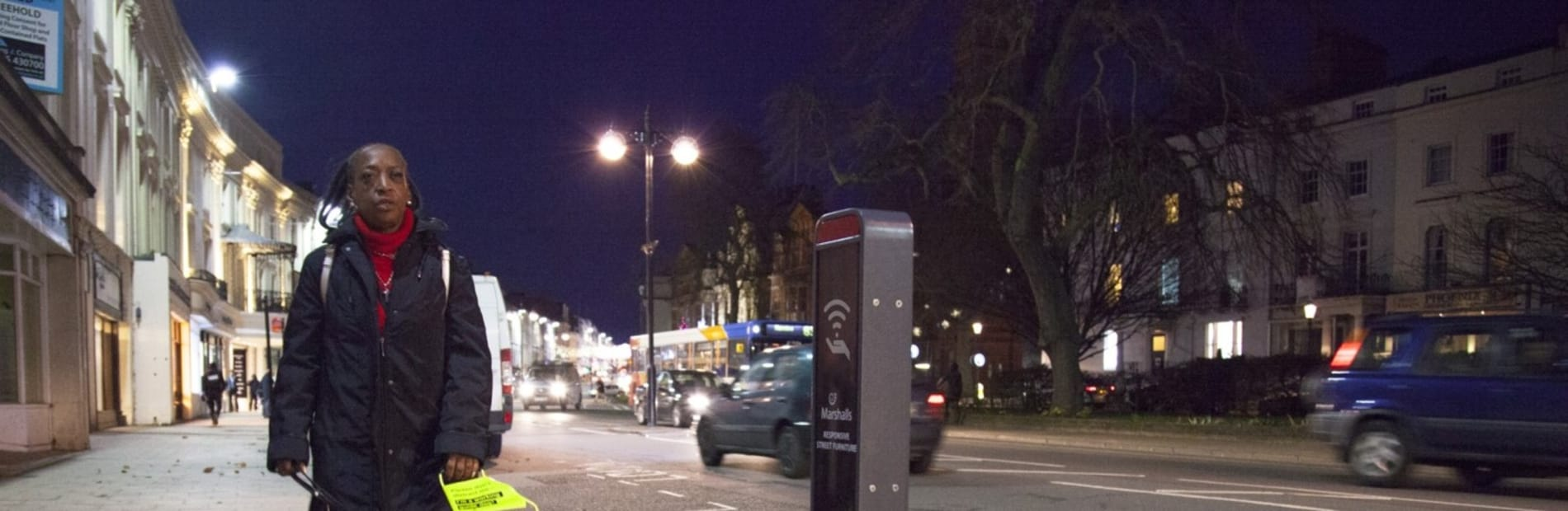 intelligent bollard on a street at night