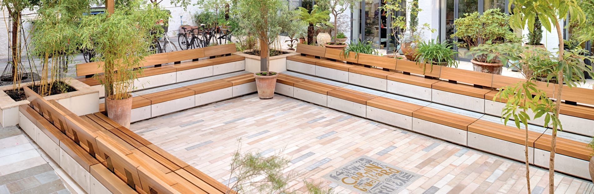 Marshalls London Design Space courtyard featuring benches and plants