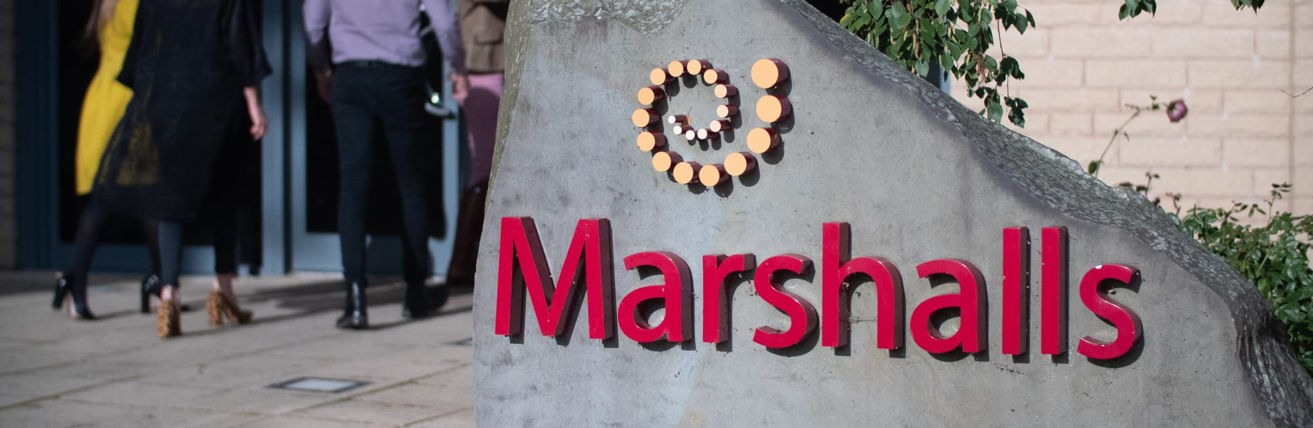 Marshalls logo in front of an office building.