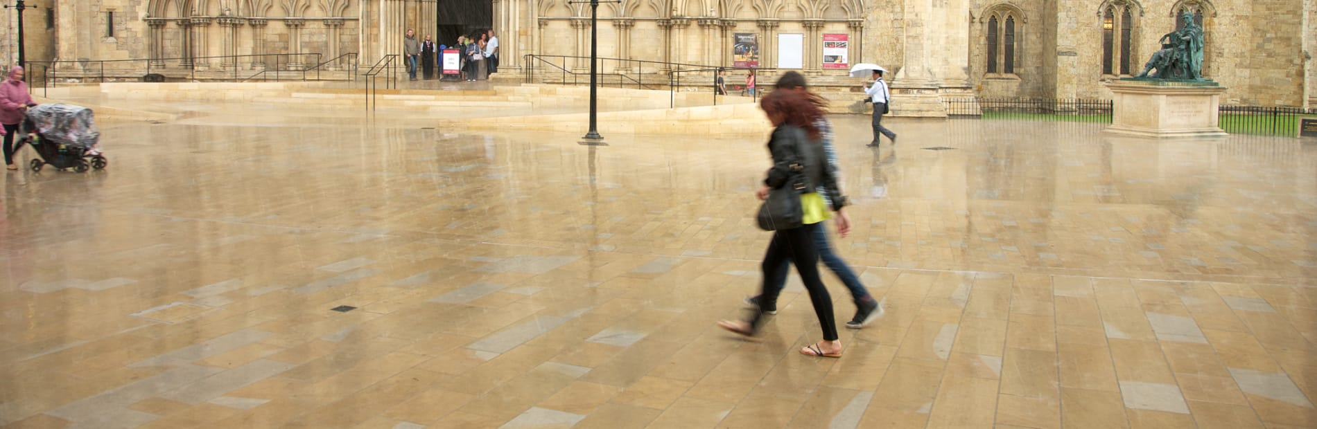 People walking outside cathedral