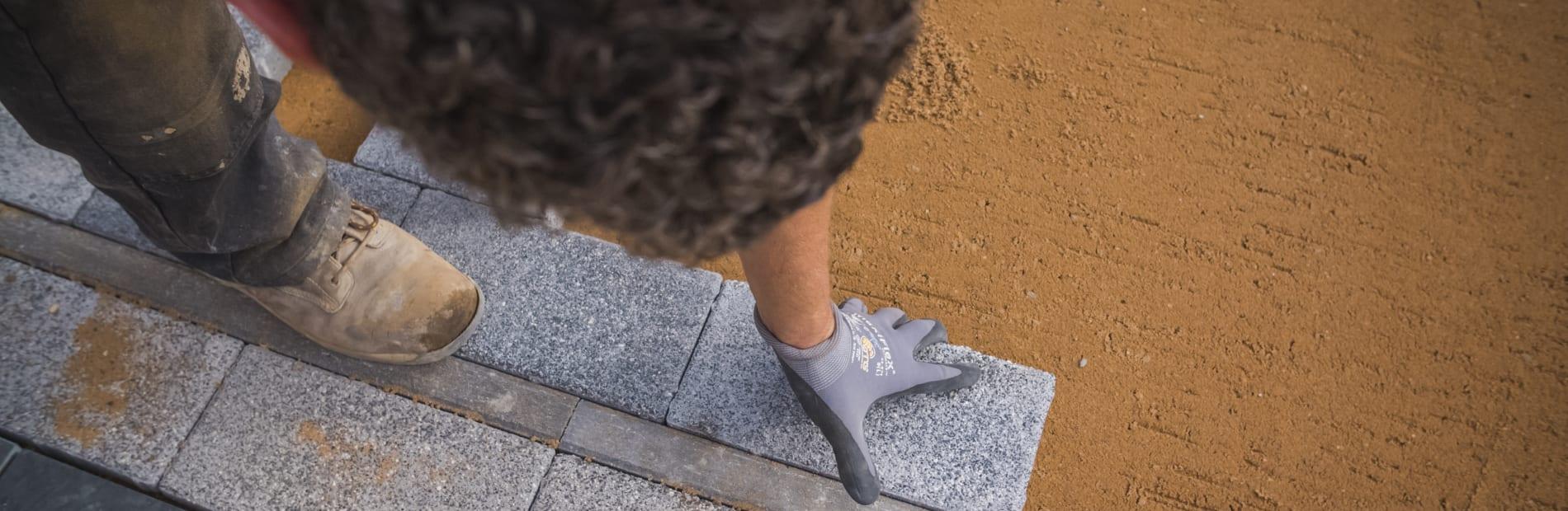 Installer laying paving