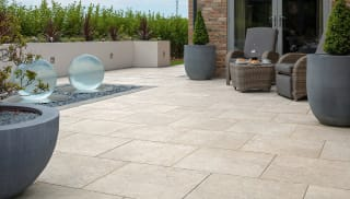 Dark grey paving used on a garden patio.