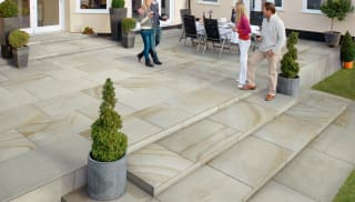 Marshalls Jumbo Sawn Versuro paving liad in a garden patio.