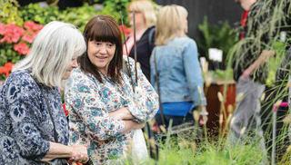 2 women looking at a flower garden