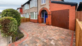 A stylish block paving driveway design for a small front garden