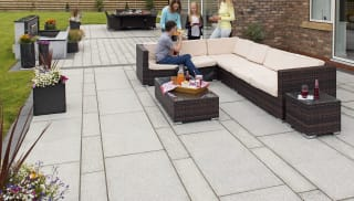 marshalls granite eclipse garden paving laid in a patio area.