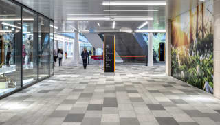 Natural stone paving laid inside Intu Watford Shopping Centre.