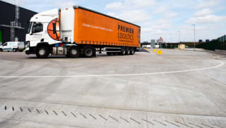 Industrial loading and unloading with linear drainage present