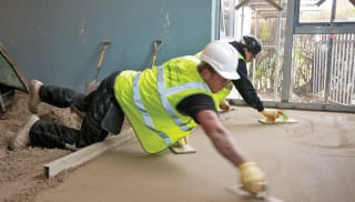 screed being used on a floor