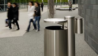 Geo litter bin with pedestrians walking by