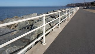 Railing and post on the seafront