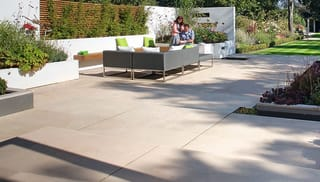 large buff paving slabs in a large garden area.