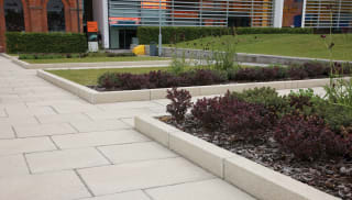 saxon textured kerb laid in a car park of a commercial building