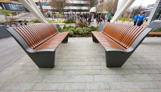 Brown seating in front of an office.