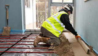 Builder laying screed