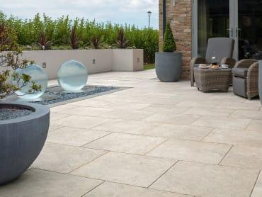 Dark grey paving used on a garden patio.