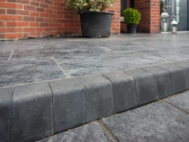 marshalls keykerb in charcoal as a step on a small patio area