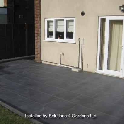 Grey garden paving laid in a garden patio area.