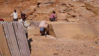 Men working in a quarry in India
