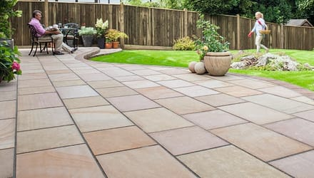 buff paving laid on a garden patio area.