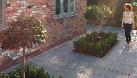 dark grey paving laid in a patio area.