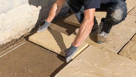 how do i lay a patio on sand