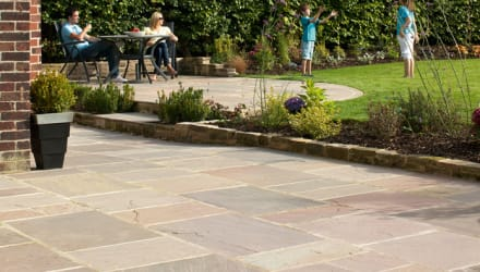 brown and buff paving coloured paving laid in a garden area.